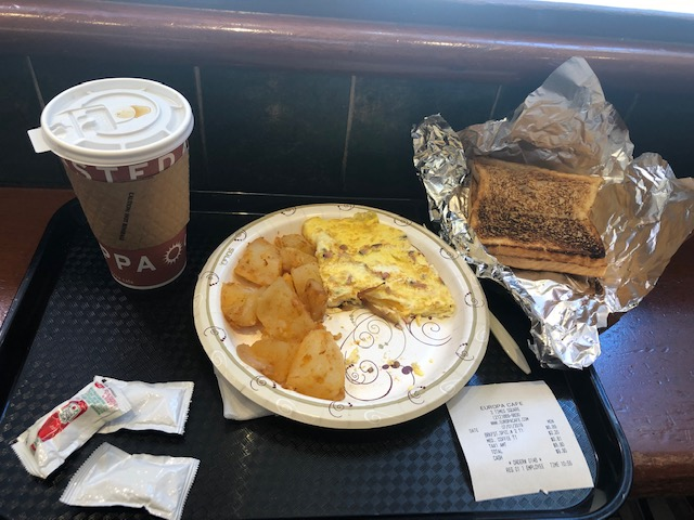 Coffee, omelette, potatoes, toast