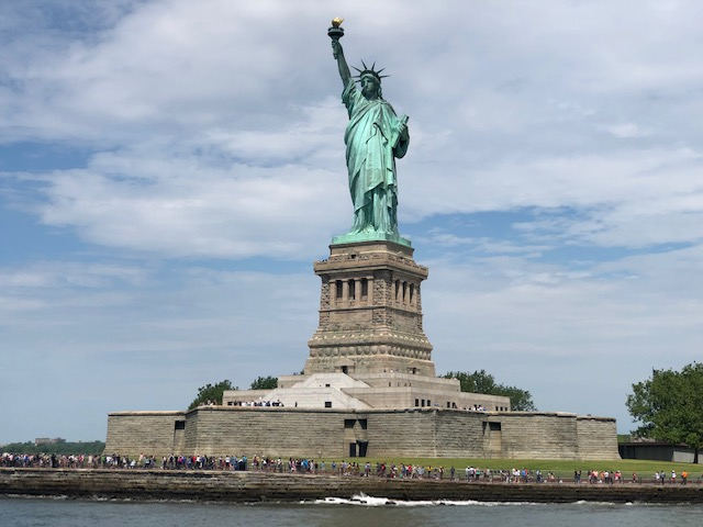 The Status of Liberty from the ferry, including the entire star base