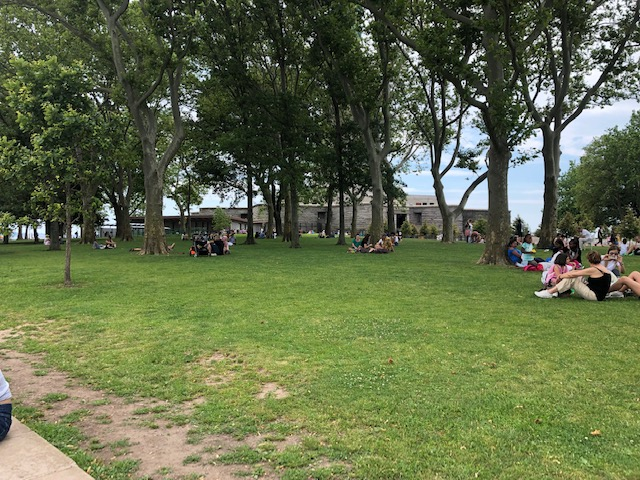 A lawn with people sitting all over