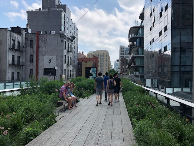 A portion of the High Line, sidewalk flanked by vegetation