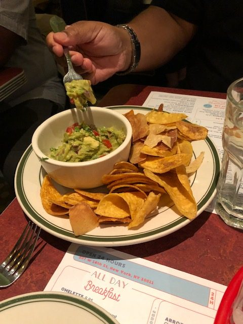 Guacamole with traditional tortilla chips as well as fried plantains