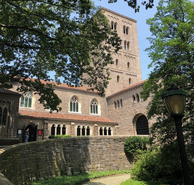 The outside of The Cloisters Musuem - big brick building with a classic design, and a tower