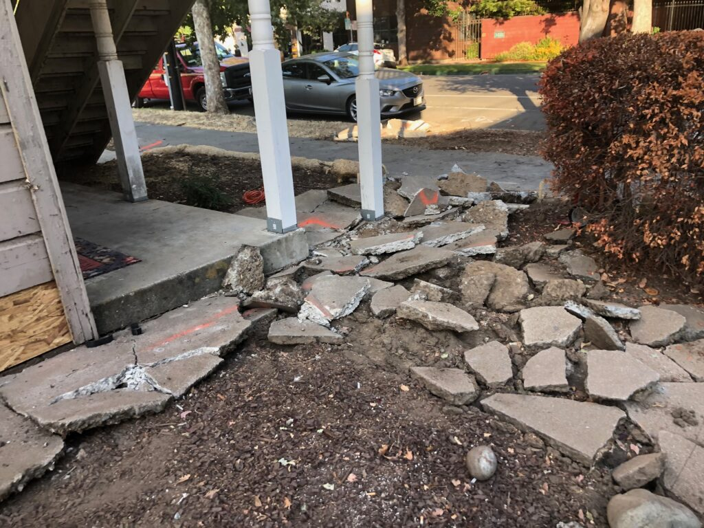torn up concrete around the front of the house