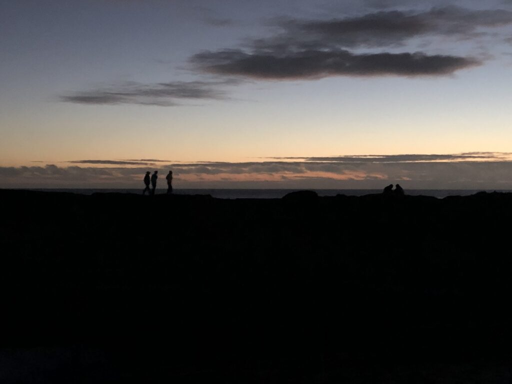 a nice silhouette of people in the distance against the last stages of sunset
