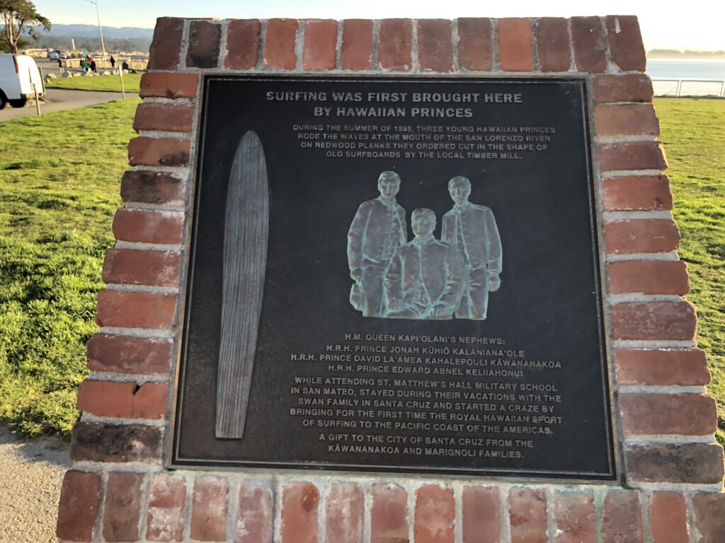 A plaque opposite the door that describes how surfing came to California