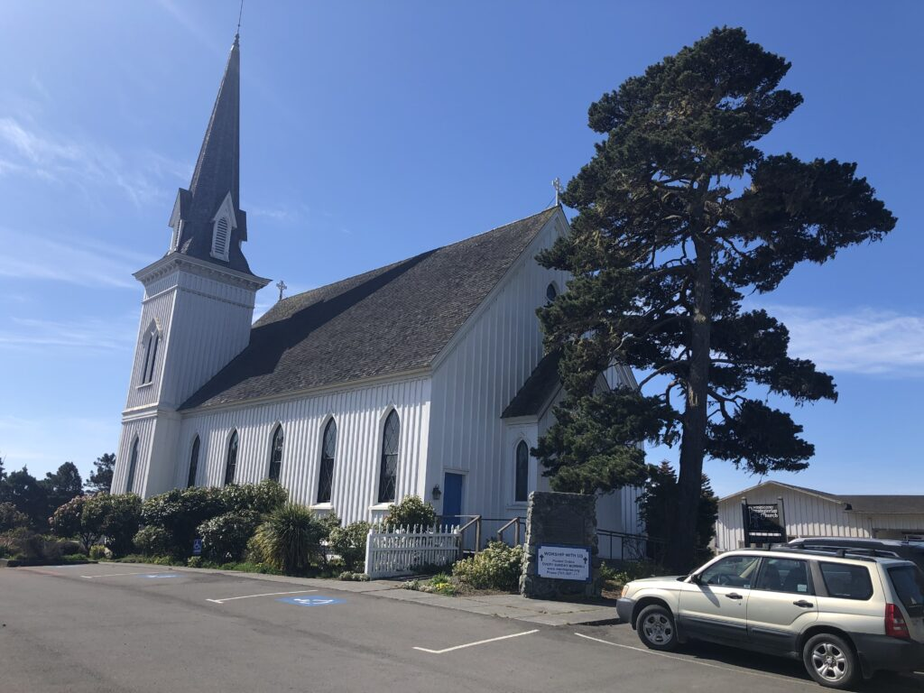 """Photo of """"the back"""" of the church as seen from the street."""