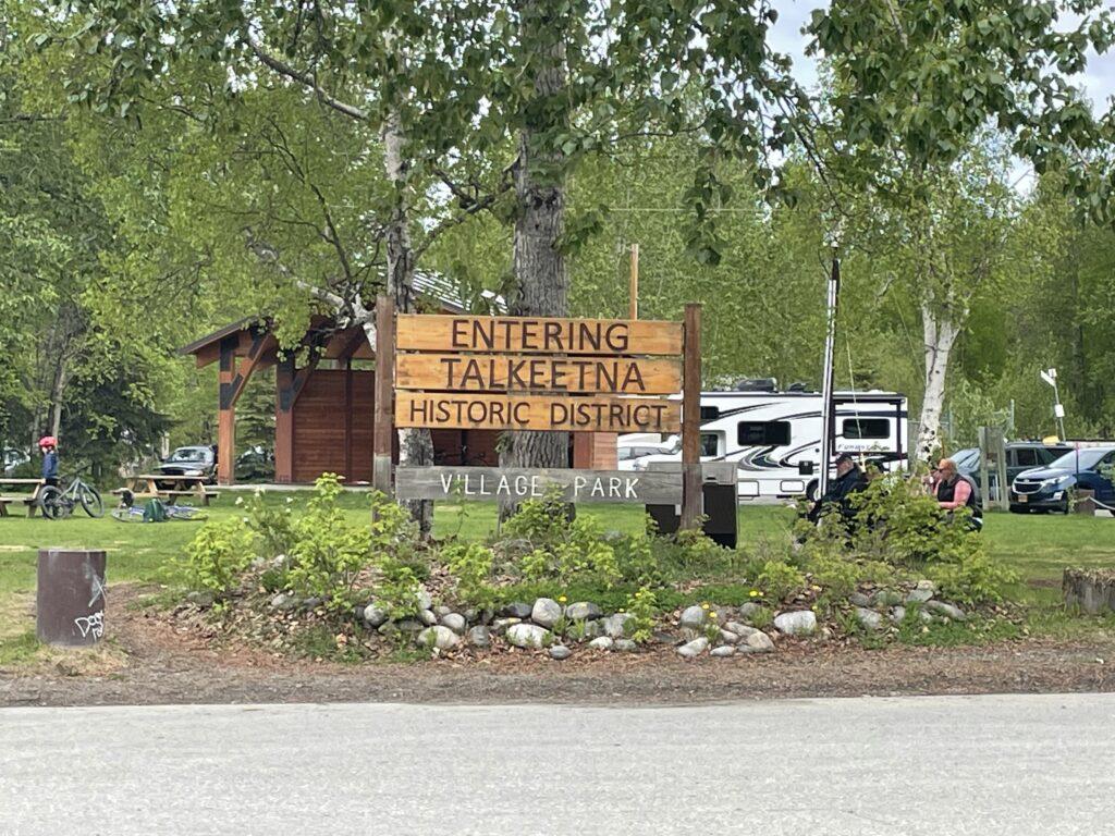"""A big wooden sign says """"Entering Talkeetna Historic District"""""""